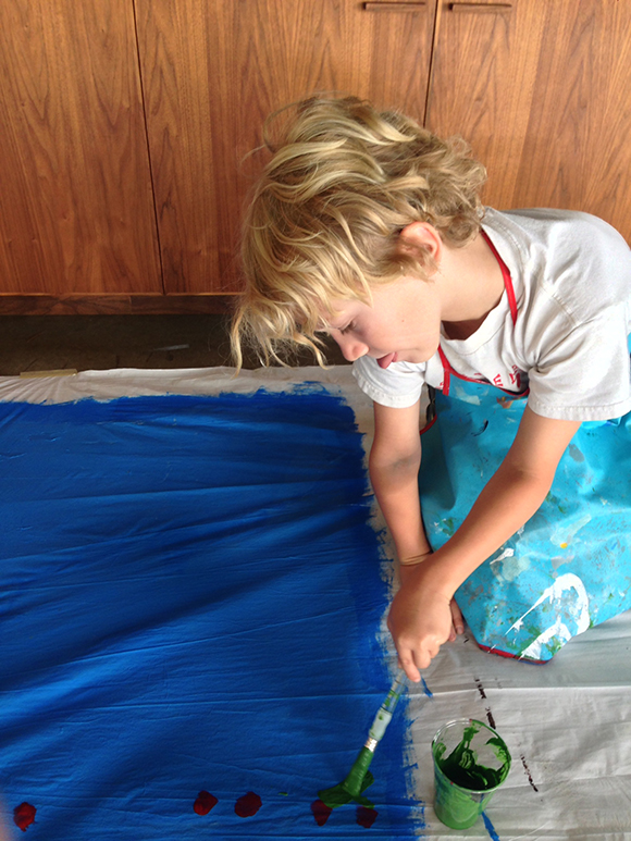 Harrison Andrews painting on cloth at the Summer Art Camp Puppets and Paul Klee | Courtesy of The Cool School Los Angeles