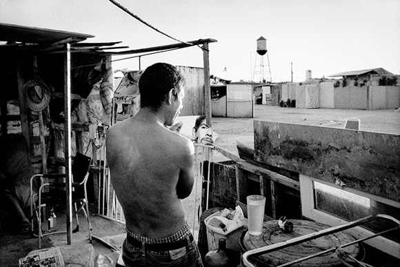 Jobless man shaves at his shantytown home. Fresno, California. The Dispossession | Photo: Matt Black