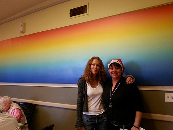 Artist Fawn Rogers with Activities Director Adriana Casanova in the common room at Alexandra Care Center, Hollywood.