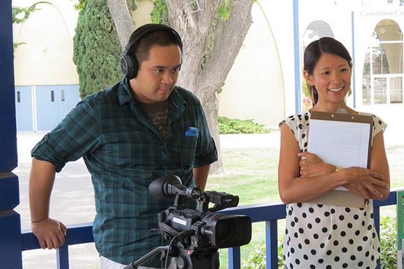 Cal Poly LAES student Jeffrey Cabanez and professor Grace Yeh interview Filipino families for her Re/Co digital archive project.   Photo: Catherine Trujillo.