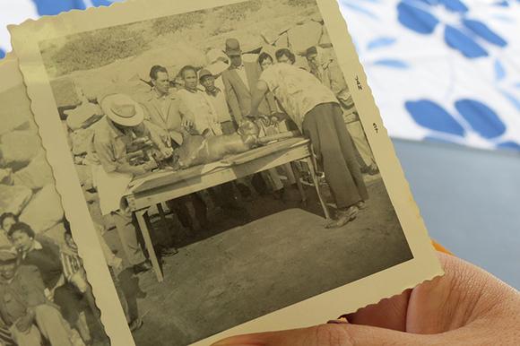 "Nedina Asencio holds an archival photo of her great-uncle Emilio ""Milan"" Sabio Maratas.   Photo: Catherine Trujillo."