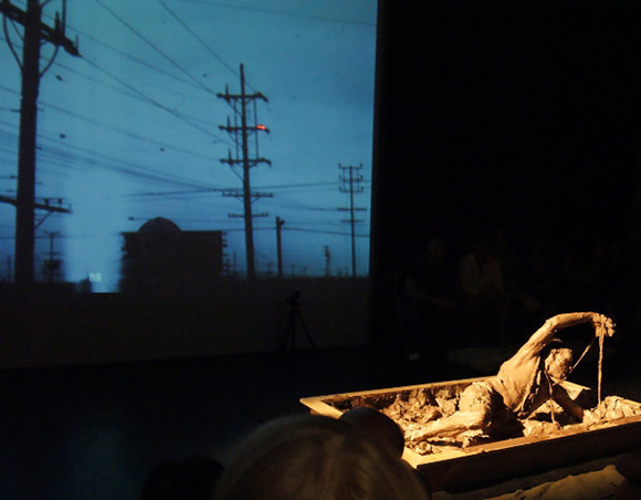 "Mike Mollett performing in ""Hold Your Mud, LA,"" a performance directed by Barbara T. Smith; Highways Performance Space, 2009. Photo: Van Don Jordan."