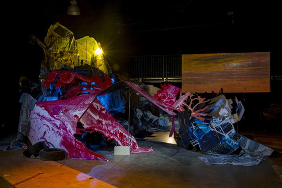 Katie Grinnan, Junkpile (stage set/sculpture), 2012, Crescent City Opera, Los Angeles, inkjet prints on PETG, C-prints on Sintra, inkjet prints on fabric, piano hinges, aluminum angle, pipe fittings, rebar, concrete, wood, paint, tires.