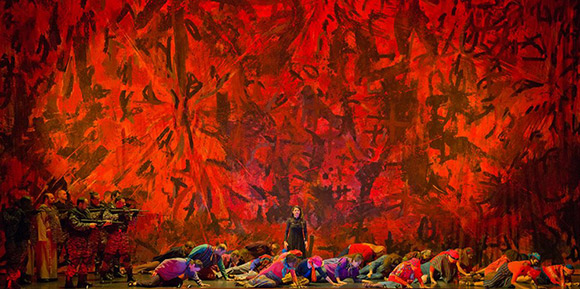 "Photo from ""The Indian Queen"" opera by Peter Sellers, set design by GRONK with ""Human Denial"" as the backdrop."