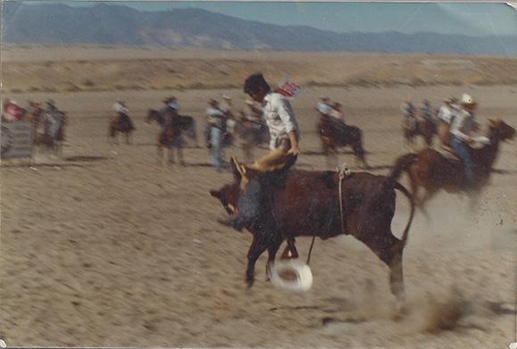 Nicholas Guzmán riding a bull, date unknown.