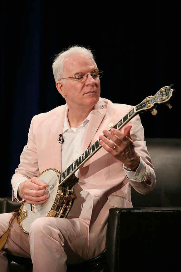 Steve Martin plays the banjo during The Un-Private Collection: Eric Fischl and Steve Martin, an art talk presented by The Broad museum and held at The Broad Stage on Monday, June 23, 2014, in Santa Monica, Calif. | Photo by Ryan Miller/The Broad