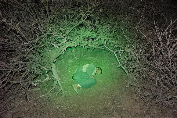 Photographer Paul Turounet spends a cold night along La Frontera in Under the Green Moon. | Photo: © 2012 Paul Turounet.