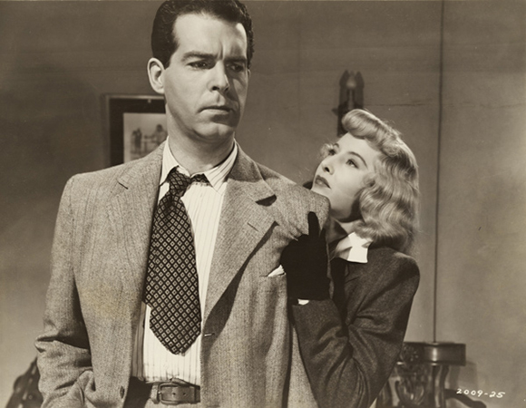 "Film Still for ""Double Indemnity "" (1944), © Paramount Pictures. Courtesy of the Margaret Herrick Library, Academy of Motion Picture Arts and Sciences. Shown from left: Fred MacMurray, Barbara Stanwyck.g"