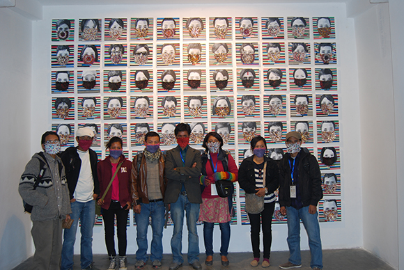 """Hit Man Gurung with his students and friends in front of """"How Long Can I Hold My Breath...,"""" 2012. 