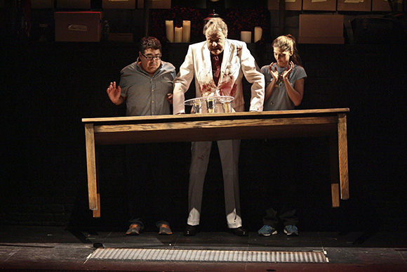 Spirits aren't the only things that get raised when audience members and Todd Robbins play with a Ouija board in the Geffen Playhouse production of Play Dead, created by magicians Robbins & Teller. |Michael Lamont
