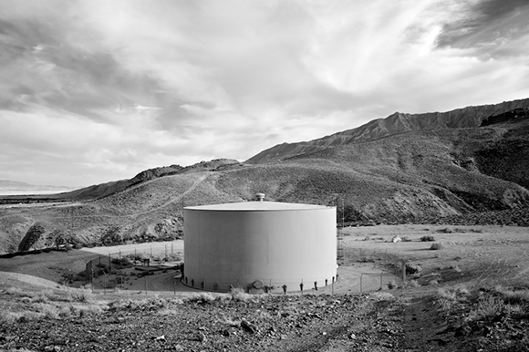 Water Tank, Lone Pine, CA, Infrared Exposure, 2013. 'Despoiled' vista receives more formal treatment. Dogs instructed to clear frame prior to exposure. | Photo: Osceola Refetoff.