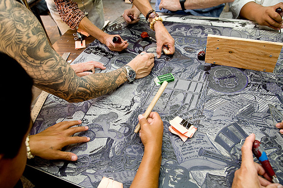 Printmaking class -- carving a linoleum block, San Quentin State Prison. | Photo: Peter Merts