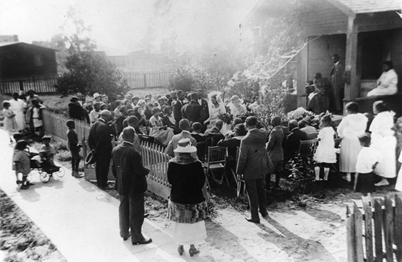 A crowd gathers for John and Helen's  wedding  in the front yard of the groom's family home on 111th Street near Compton Avenue in Watts. | Courtesy of the Los Angeles Public Library