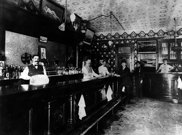 The interior of Union Bar at 3rd Street and Central Avenue, in Los Angeles. Joseph, the owner, is at the left, standing behind the bar. | Courtesy of the Los Angeles Public Library