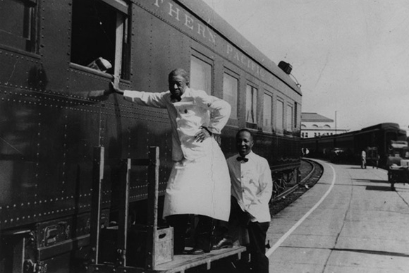 Charles, left, and Frank, waiters for the Southern Pacific Company, seen at the Central Station at 5th Street and Central Avenue in Los Angeles. | Courtesy of the Los Angeles Public Library