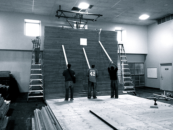 Wall construction, with technical directors Jeff Williams and Alec Cyganowski, and crew members Paul Buice, Kenneth Bryantd and Michael Cherry. | Photo: Shannon Scrofano
