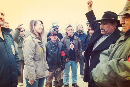 BLM officials (far left) sent to evict activists. Wally Antone (Quechan), right; AIM member (far right), Feburary 13, 1998. | Photo: Greenaction