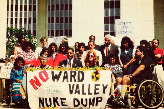 Colorado River Native Nations Alliance (CRNNA) activists along with Reverend Jesse Jackson conduct a spiritual vigil at the LA Federal Building on December 14, 1995.  | Photo: Phil Klasky
