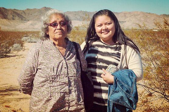 Drusilla Burns (Mojave elder) and her Grandaughter Ashley Hemmers at the 17th Ward Valley reunion in 2015. | Photo: Kim Stringfellow.