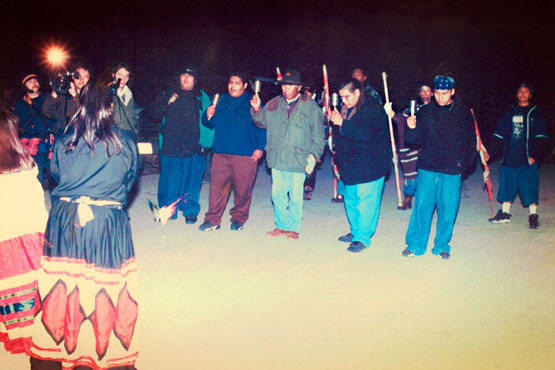 Quechan Lightning Singers and dancers at front line of occupiers blocking police from entering Ward Valley, February 13, 1998. | Photo: Greenaction.