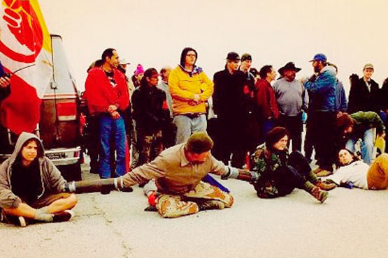 Activists holding the line at Ward Valley occupation, 1998. | Photo: Molly P. Johnson.