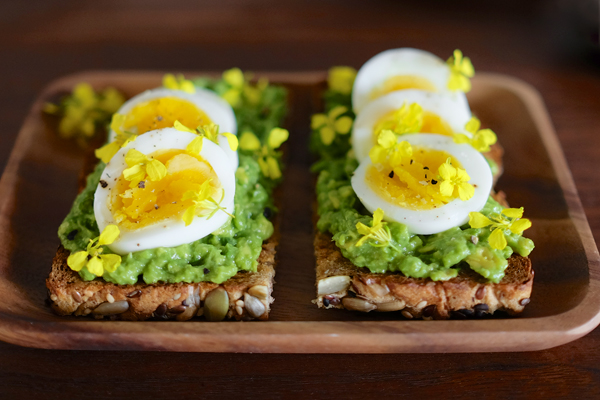 Avocado and Egg Toast with Wild Mustard Flowers (photo by Gregory Han)