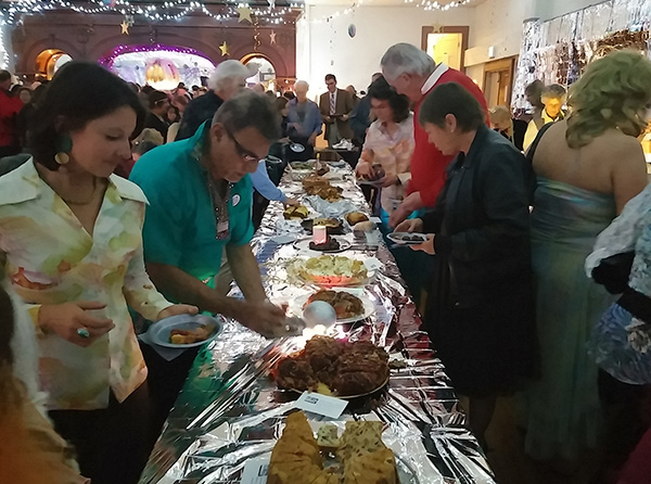 Guests at the annual Fruitcake Festival in the Inyo county town of Independence sample 1970s disco-themed fruitcakes in December 2014.