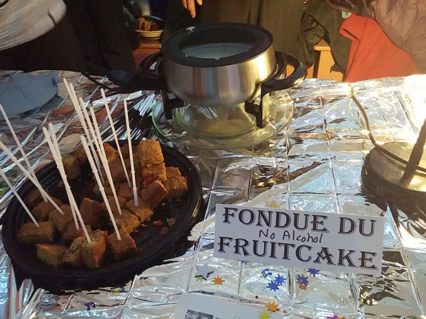 A fondue fruitcake from the 2014 festival pays tribute to that year's 1970s theme.