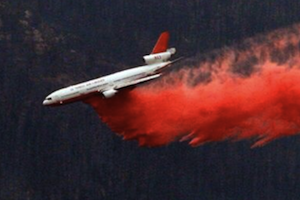 A Very Large Air Tanker (VLAT) drops retardant on the fire. | Photo: Courtesy Inciweb