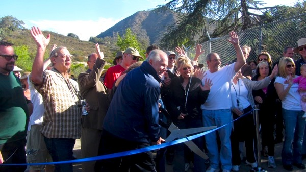 *Okay, actually, there was a funny moment when the scissors failed to cut the ribbon. Councilman LaBonge ended up just lifting it up for people to get through. | Photo: Zach Behrens/KCET