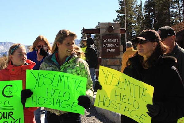 Occupy Yosemite organizer Stacey Powells, right, holds a sign next to Mammoth Lakes resident Jennifer DeAngelis. | Photo: Dan McConnell
