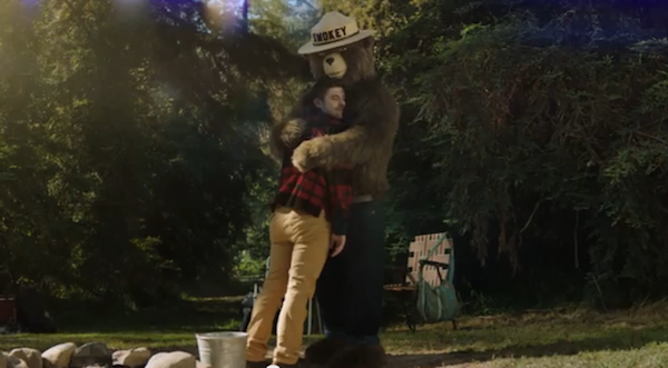 Smokey Bear now gives out bear hugs to those who prevent wildfires. | Photo: Screenshot of Ad Council commercial.