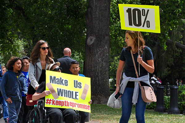 Disability rights advocates gather at the State Capitol on May 18, 2015, urging lawmakers to pass a 10 percent budget increase toward developmental disabilities services.