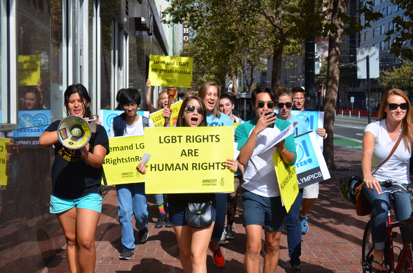 Advocates from Go Athletes, an LGBT sports coalition, walk the streets of San Francisco in protest of Russia's LGBT law.