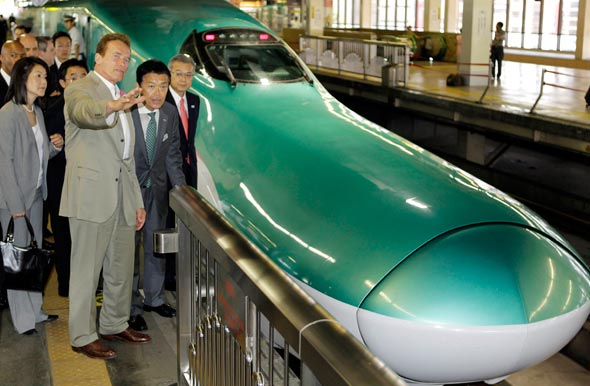 Fmr. Calif. Gov. Arnold Schwarzenegger during his inspection of Japan's high-speed train operations in Tokyo in 2010. (Photo: SHUJI KAJIYAMA/AFP/Getty Images)