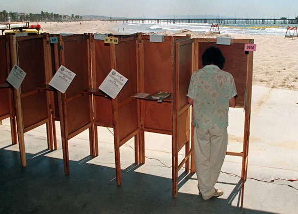 A lone voter casts his ballot at a polling booth in Venice Beach during the 1996 California state primary, which set a record low for turnout of registered voters in a presidential primary. (Photo: Vince Bucci/AFP/Getty Images)