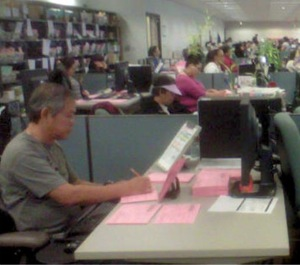 Vote by Mail ballots going through signature verification and cross-checking with precinct rosters. | Photo: Courtesy RR/CC