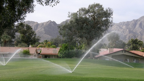 Sprinklers water a golf course in Southern California.