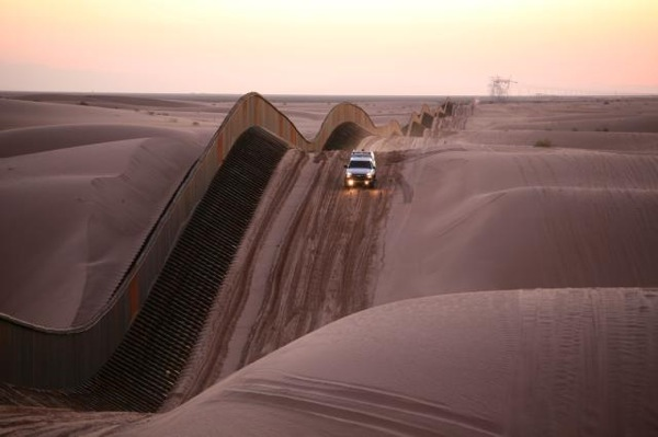 A section of the U.S.-Mexico border wall along the Imperial Dunes.