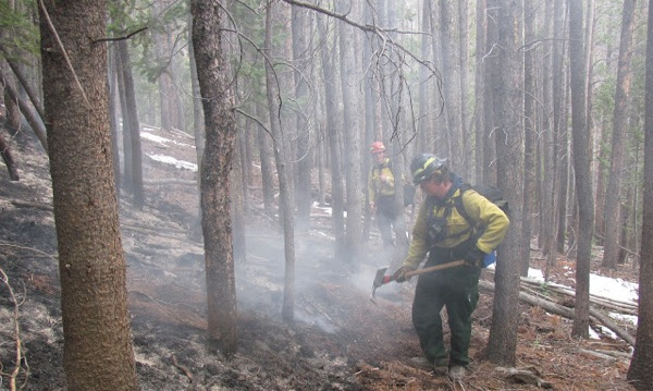 Fire fighters perform mop up operations on November 1, 2012. | Photo: Courtesy NPS