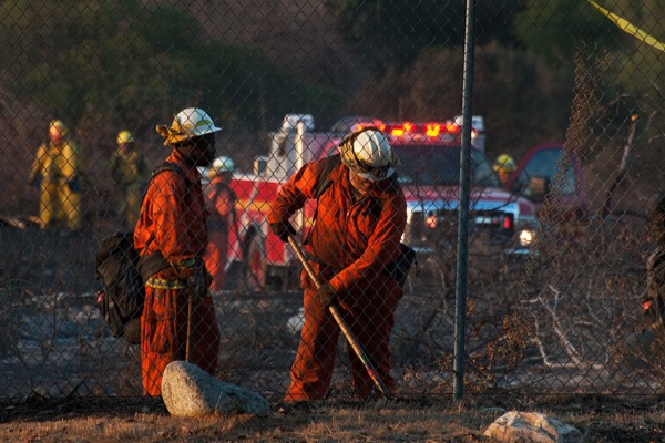 Firefighters work to extinguish a brush fire at Bernard Biological Field Station on September 11, 2013.