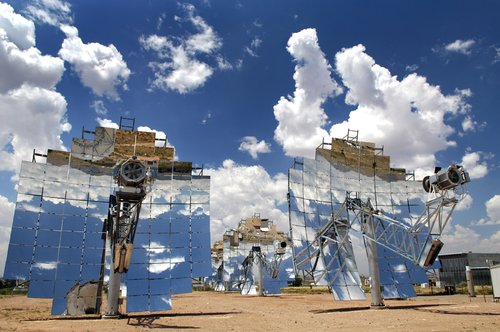 Dish-engine solar system. The solar dish generates electricity by focusing the sun's rays onto a receiver, which transmits the heat energy to a Stirling engine, which in turn drives a generator to make electricity. (Sandia National Laboratory)