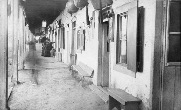 Early adobe buildings on Aliso Street, on the southern outskirt of Old Chinatown. | Courtesy of the Los Angeles Public Library
