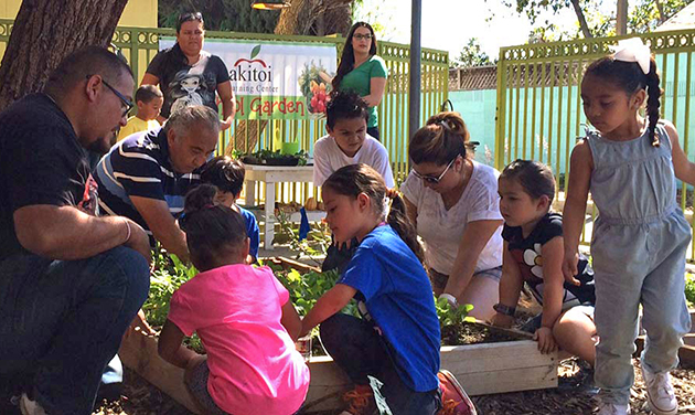 Parents and students at Akitoi Learning Center take part in a garden workshop facilitated by Earthworks Farm.  Cara Santa Maria from SoCal Connected looks on