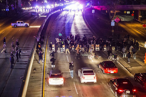 Demonstrators block a freeway on ramp in Los Angeles, California July 15, 2013. Photo by: ROBYN BECK/AFP/Getty Images