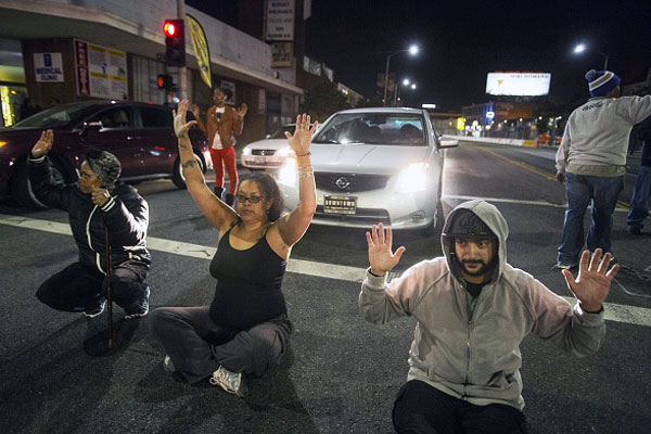 Bringing the city to a standstill, demonstrators speak out against the slew of killings of young Black men and women. November 24, 2014 in Los Angeles, Calfornia. Photo by: RINGO CHIU/AFP/Getty Images
