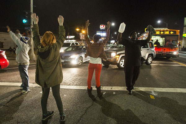 Organizers have rallied support using old and new methods ranging from door-knocking, to social media. November 24, 2014 in Los Angeles, Calfornia. Photo by: RINGO CHIU/AFP/Getty Images