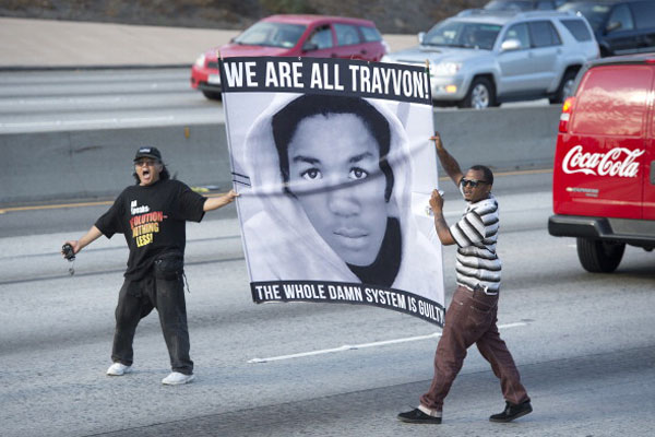Protestors in Los Angeles, CA stop highway traffic following the acquittal of George Zimmerman on July 14, 2013. Photo by: ROBYN BECK/AFP/Getty Images