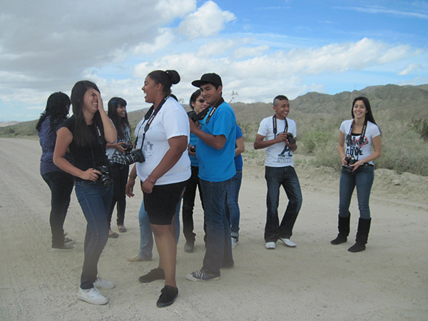 Students participating in the program gather on a road in Indian Canyon, near the town of Mecca, California and spitting distance from the Salton Sea. They explored light, shadow, focus, perspective, and depth of field. Photo by Lynn Warshafsky