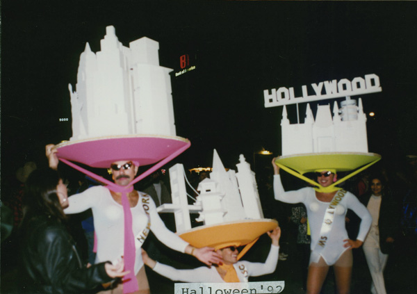 City-skyline hats at the Halloween party in West Hollywood. October 31, 1992. Image courtesy of USC.